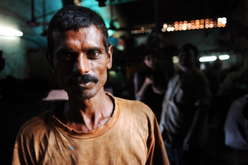 factory man in Indian slum