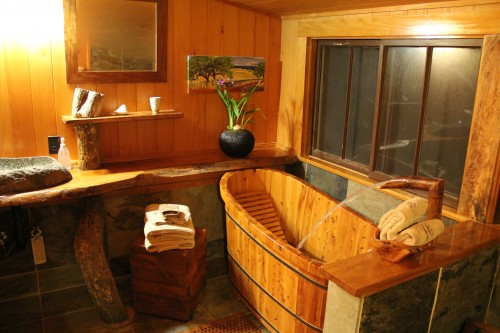 The bathroom doubles as a sauna with the rich woodwork walls