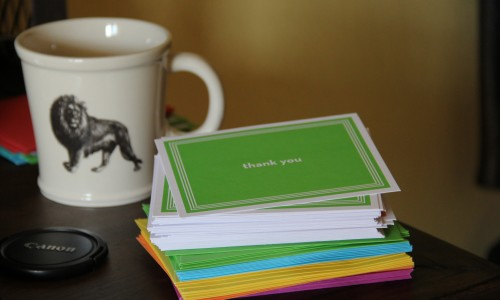 coffee cup and thank you cards