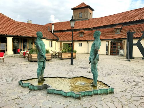 Statues peeing on the map of Czech Republic